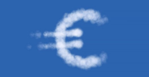 Euro symbol drawn by white clouds on blue sky